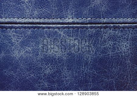 Texture blue leather with seam closeup background