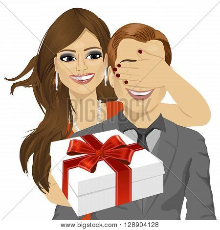 woman covering her boyfriend's eyes standing behind man with gift isolated on white background
