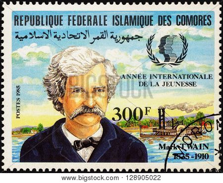 MOSCOW RUSSIA - MAY 03 2016: A stamp printed in Comoros shows portrait of Mark Twain (1835-1910) devoted to the 150th Anniversary of the Birth series