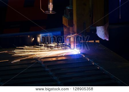 Metal sparks. Industrial laser and plasma cutting of sheet steel