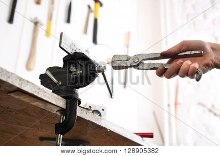 Jeweler's workshop, vise and pliers, the artist at work.