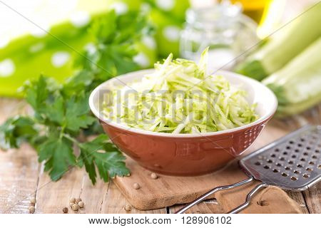 grated vegetable marrow in a bowl on table