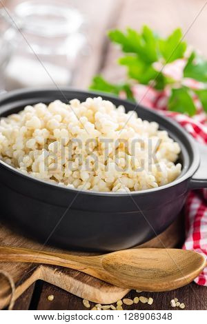 boiled bulgur porridge in a bowl on table