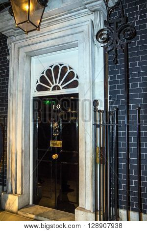 LONDON UK - JUNE 7 2015: Entrance door of 10 Downing Street. The street was built in the 1680s by Sir George Downing and is now the residence of the Prime Minister.