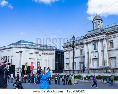LONDON UK - JUNE 7 2015: Unidentified tourists near National gallery and Trafalgar Square