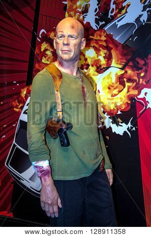 LONDON UK -JUNE 7 2015: Bruce Willis as John McClane in the Madame Tussaud wax museum. Marie Tussaud was born as Marie Grosholtz in 1761