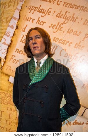 LONDON UK - JUNE 7 2015: Wax figure of Oscar Wilde (1864-1900) at Madame Tussaud museum. It is one of major tourist attraction.