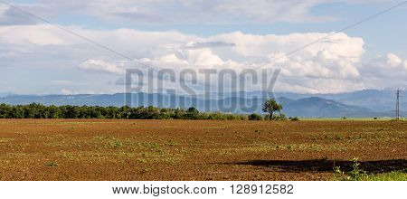 Idyll nature landscape of farm lands and cloudy sky