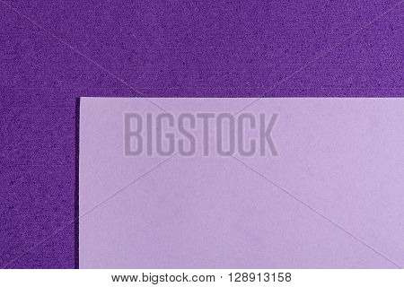 Eva foam ethylene vinyl acetate smooth light purple surface on purple sponge plush background