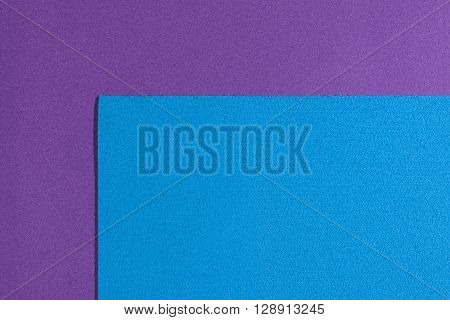 Eva foam ethylene vinyl acetate sponge plush blue surface on purple smooth background