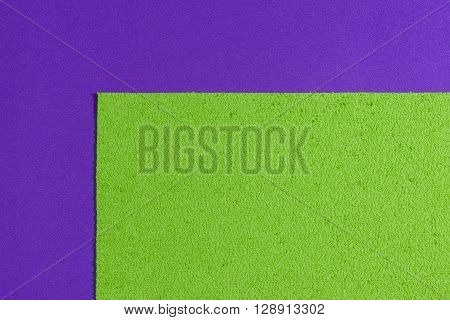 Eva foam ethylene vinyl acetate sponge plush apple green surface on purple smooth background