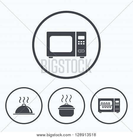 Microwave grill oven icons. Cooking pan signs. Food platter serving symbol. Icons in circles.