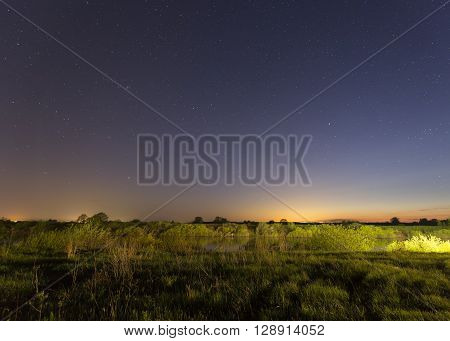 Stars on the sky and small river at night