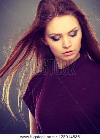 Glamour and beauty. Portrait of gorgeous glamorous fashionable woman with long straight dark hair waving. Stunning young elegant lady.