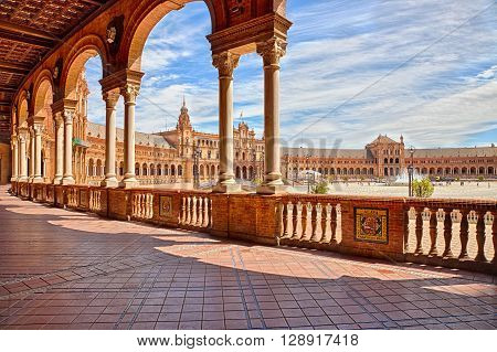 Seville, Andalusia, Spain.circa April 2016:The famous Square of Spain, in Spanish Plaza de Espana, view from the path with columns, one example of the mixing Regionalism Architecture Renaissance and Moorish styles.