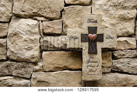 Hope Faith and Love Stone Cross with Stone Background