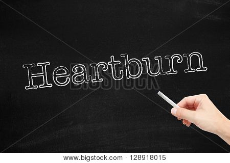 Heartburn written on a blackboard