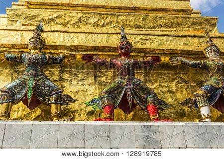 Three Statues of Giant Guardians in front of the golden pagoda at Wat Phra Keaw temple (Emerald Buddha), Bangkok,Thailand