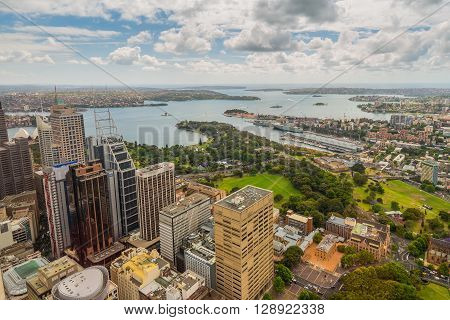 Sydney Australia - November 11 2014: Aerial view of Sydney CBD Royal Botanic Garden and harbour from Sydney Tower Eye in cloudy weather Sydney New South Wales Australia.