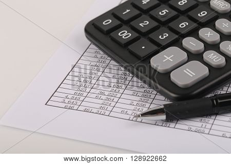 Calculator And Pen On Sheet