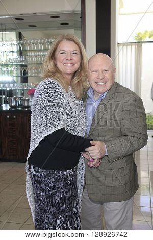 PALM SPRINGS - APR 27: Meg Thomas, Jeffrey Lane at a cultivation event for The Actors Fund at a private residence on April 27, 2016 in Palm Springs, California