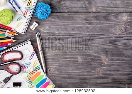 Office supplies on grayish wooden background with copy space