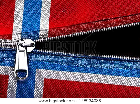 Metal zipper on Norway flag synthetic fabric with black copy space Independence day concept