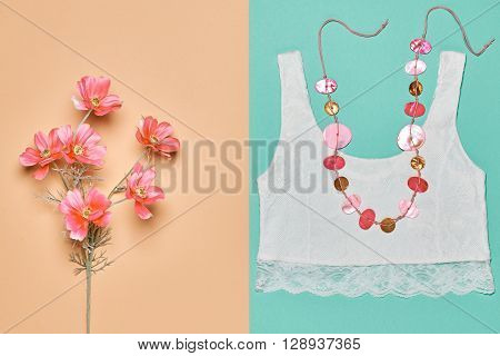 Elegant trendy date outfit. Fashion woman clothes accessories set. Glamor lace top, stylish necklace and summer pink flowers. Unusual creative girl. Overhead, romantic.Top view, vanilla background