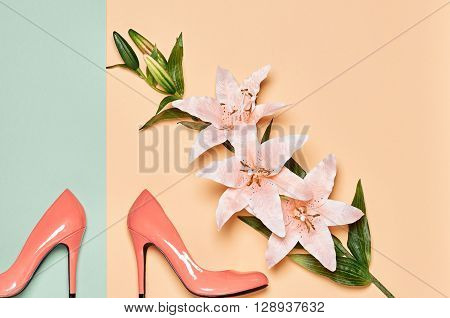 Fashion woman accessories set. Glamor luxury shoes heels and summer lily flowers. Elegant trendy girl. Unusual creative look. Overhead, romantic. Top view, vanilla pastel background