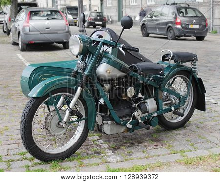 COPENHAGEN - MAY 19 2012: Old Motorcycle Nimbus at the famous Christianshavn district in Copenhagen. The Nimbus was a Danish motorcycle produced from 1919 to 1960. May 19 2012