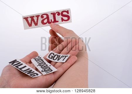Torn Newspaper Titles on hand on  a white background