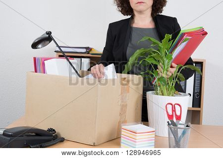Office Employee With Collected In A Box Things Standing Near Desktop