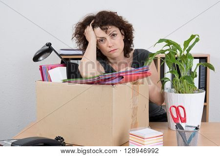 Hopless Employee With Collected In Box Things Sitting Near Desktop
