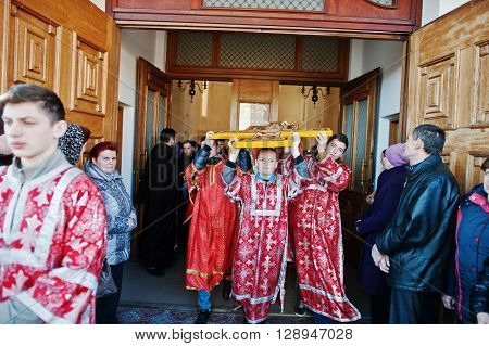 Lviv, Ukraine - April 27, 2016: Holy Week Passion And Death Of Jesus Christ. Children Carry Crucifix