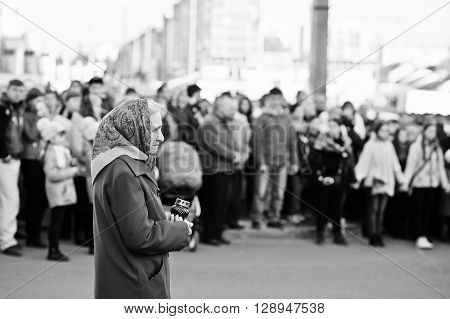 Lviv, Ukraine - April 27, 2016: Holy Week Passion And Death Of Jesus Christ. Old Elderly Woman. Blac