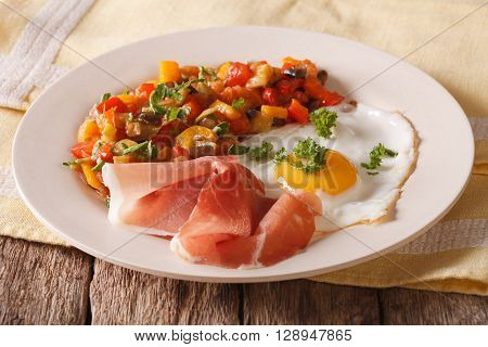 Spanish Cuisine Fried Egg, Jamon And Vegetable Stew On A Plate Close-up.