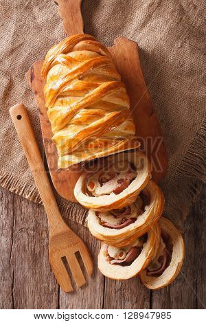 Sliced Bread Stuffed With Ham And Olives Close-up Vertical Top View