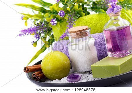 Spa setting aromatherapy and health care items isolated on white