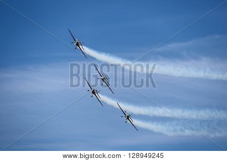 Flying aircraft during air show in a sunny day