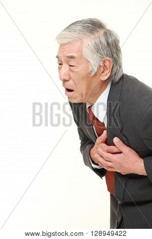 portrait of senior Japanese businessman heart attack