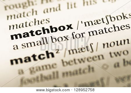 Close Up Of Old English Dictionary Page With Word Matchbox.