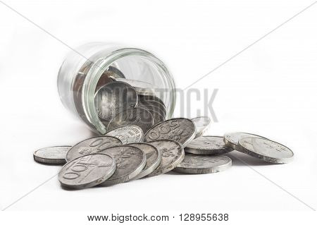 Isolated Rupiah Coin inside of Transparent Jar