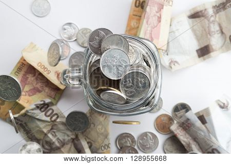 Rupiah Coin Inside Of Jar
