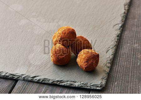 Homemade chocolate truffles on slate plate