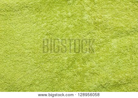clean green terry towel texture background closeup