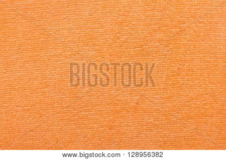 orange terry towel texture background close up
