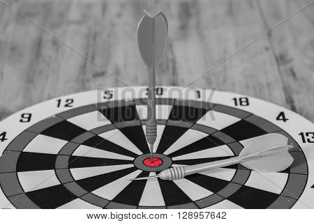 black and whitte tone , Dart hit the center of dartboard