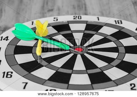 black and whitte tone , dart arrow on dartboard