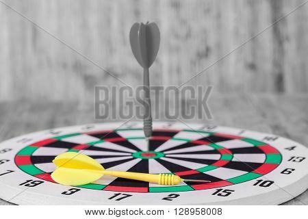 black Dart hit the center of dartboard