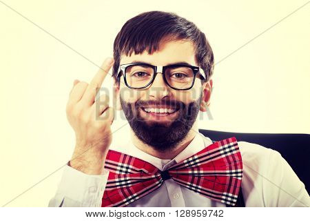 Young old fashioned man showing middle finger.